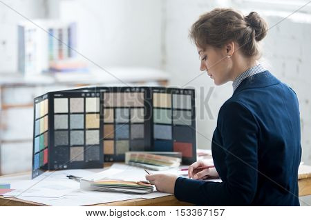 Female Architect Choosing Materials