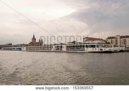 Vienna / Austria - July 21st 2014: Danube landscape scene showing some cruise ships docked and prepared for the journey