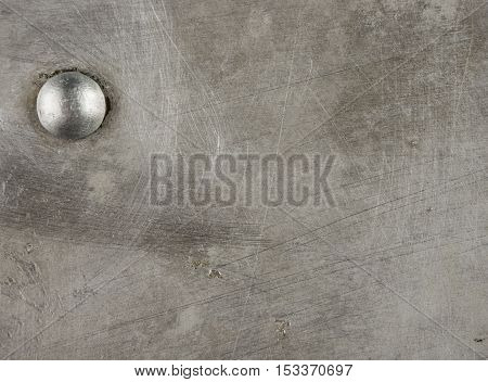 texture of the old aluminum surface with rivets, corrosion, scratches, and dents