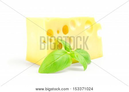 cheese and basil leaves on a white background.