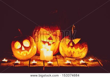 Halloween Pumpkins Head Jack Lantern On The Old Boards In A Spooky Night Landscape. Soft Focus. Shal