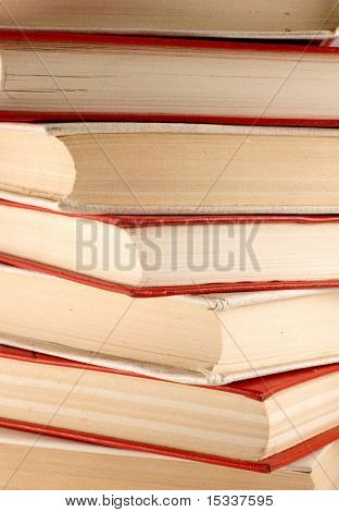 Stack of red and white old books