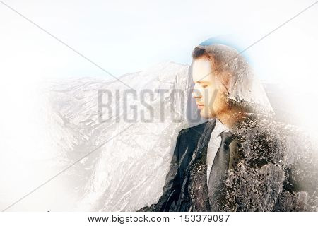Side view of thoughtful young businessman on abstract landscape background with copy space. Double exposure