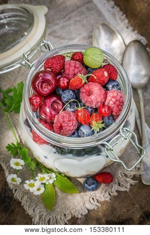 Closeup of tasty muesli with flowers and fruits