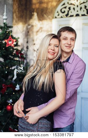 love young couple near the tree. christmas