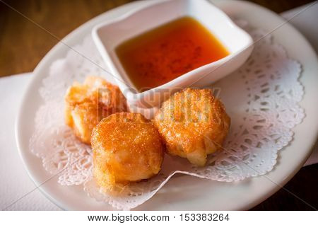 Delicious Chinese Dim Sum shumai dumplings topped with sweet sauce