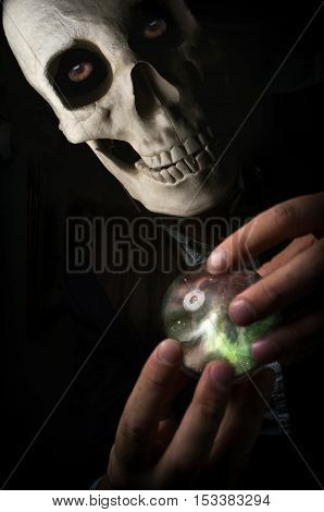 Angel of death holding magic crystal ball to decide fate
