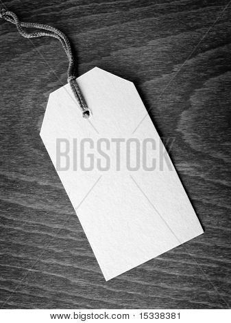 Blank tag on wooden background