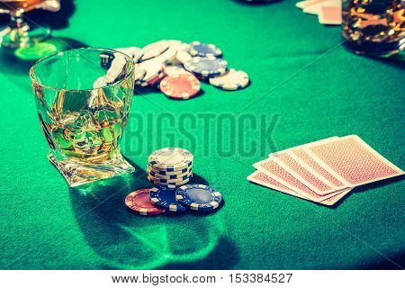 Closeup Of Table For Poker With Whiskey, Cigar And Cards