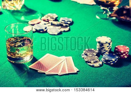Old Table For Poker With Whiskey, Cigar And Cards