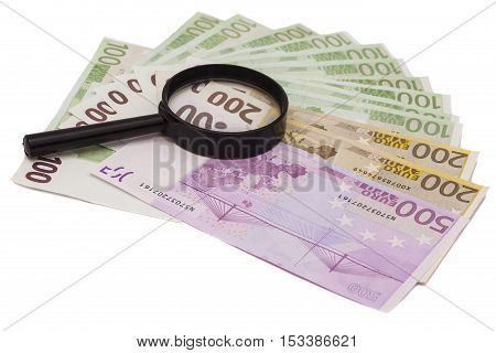 Euro banknote under magnifying glass isolated on white