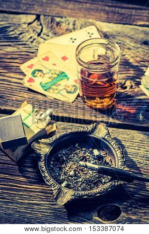Old Table For Illegal Poker With Vodka, Cigarettes And Cards