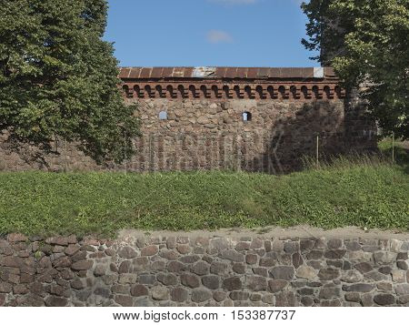 Old stonework of the fortress wall. Summer days