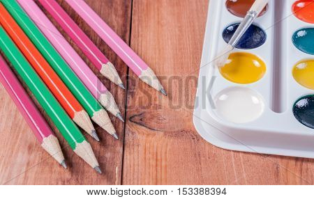 Accessories for painting Colorful paint brushes on white background