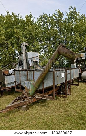 ROLLAG, MINNESOTA, Sept 1. 2016: An old Rumely combine and homemade grain bin are displayed at the annual WCSTR farm show in Rollag held each Labor Day weekend where 1000's attend annually