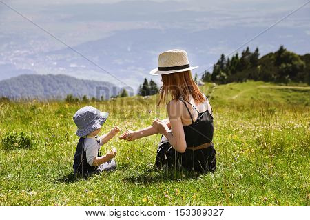 Mother And Son On The Nature Background.