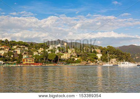 SANTA MARGHERITA LIGURE, ITALY - SEPTEMBER 2016 : Evening view of hotels restaurants houses and sailing boats at Tigullio Gulf of Santa Margherita Ligure, Italy on September 22, 2016