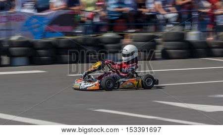 GALATI ROMANIA - September 11 2016: Boy drive karting car on a track to demonstrate the spectators the speed. Panning view
