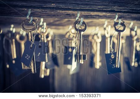 Closeup of aged hotel with keys for rooms