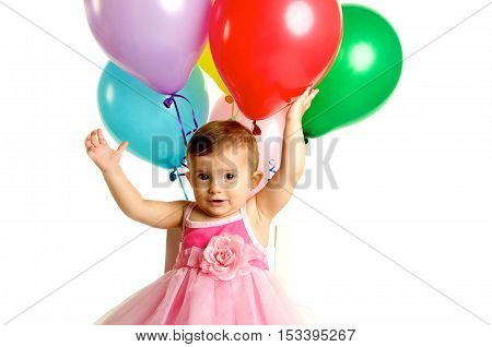 Cute One Year Old Baby Girl Celebrating her birthday with balloons. Shot on a white background
