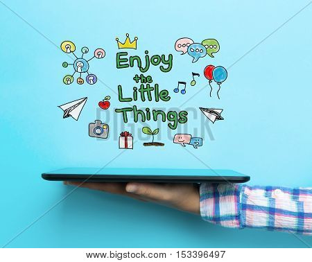 Enjoy The Little Things Concept With A Tablet