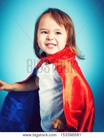 Toddler Girl Playing In A Super Hero Cape