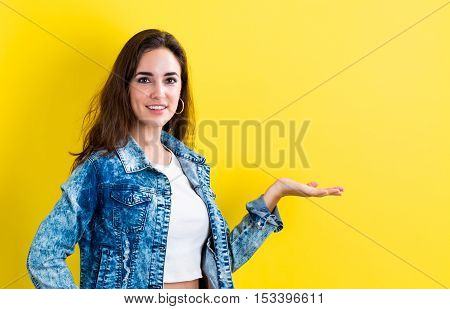 Young Woman With A Displaying Hand Gesture