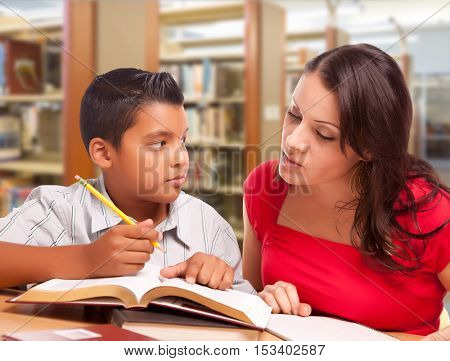 Hispanic Mother and Son Studying Inside The Library.