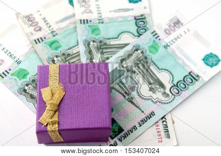 Violet box with golden bow on thousands of rubles worth