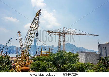 Industrial Cargo freight ship with working crane bridge in Hong Kong