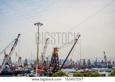Hong Kong, China - 29 AUGUST, 2016: Industrial Cargo freight ship with working crane bridge in Hong Kong