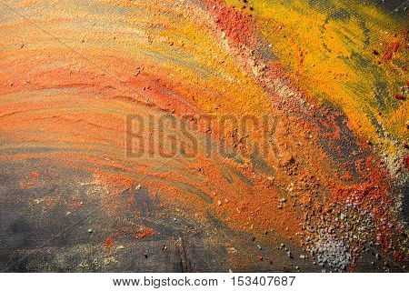 Mess with vivid spices as background on old wooden table