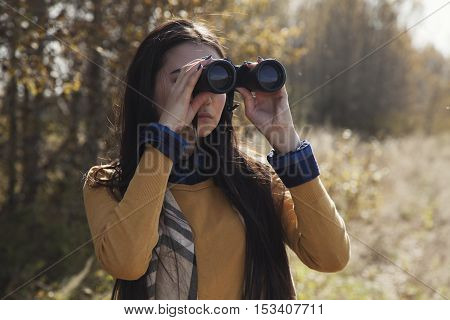 Beautiful Asian Young Woman Looking In Field-glass