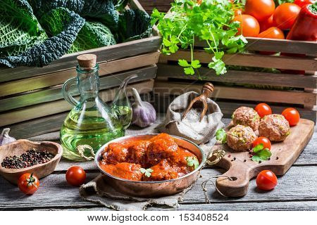 Preparation For Meatballs With Tomato Sauce And Parsley