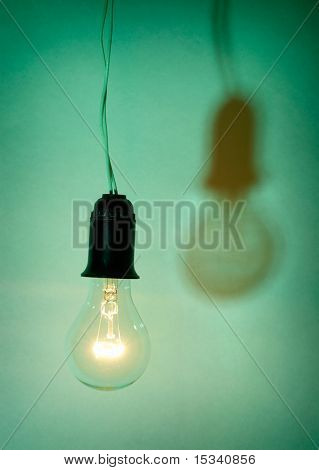 Photo of light bulb on green background
