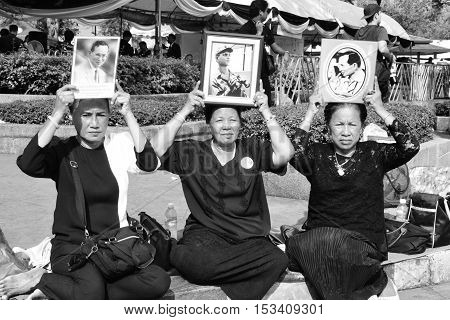 Bangkok Thailand- OCT 22 2016: The people hold the portrait of King Bhumibol Adulyadej at Sanam Luang in front of the Royal Palace to pay respect for the king on OCT 22 2016 Bangkok Thailand.