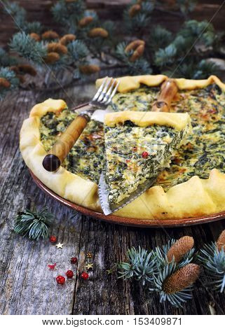 New Year mood: spinach quiche and pine branches