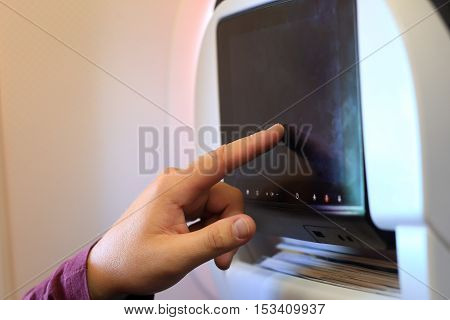 Hand Touching Lcd In Passenger Chair