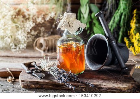 Medicine In Bottles Made Of Honey And Fresh Herbs