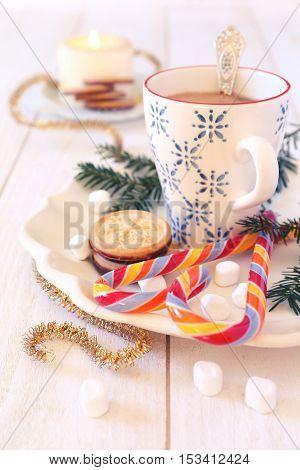 New Year's mug of coffee milk and christmas sugar cookies. Toned image