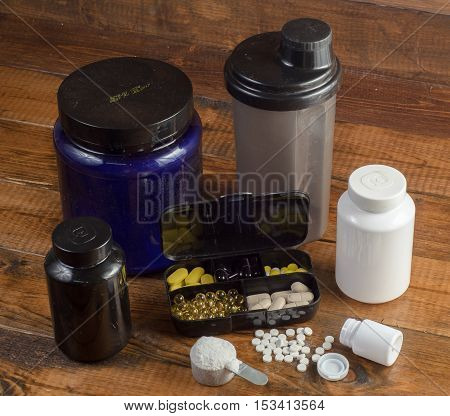 Sport and Fitness Supplement on a wood background