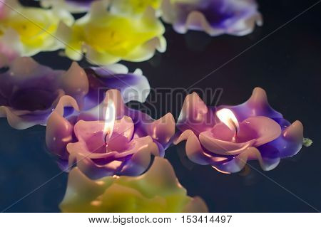 Fire on candle light flower on the water