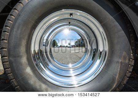 Mirrored chrome cover of vintage car wheel