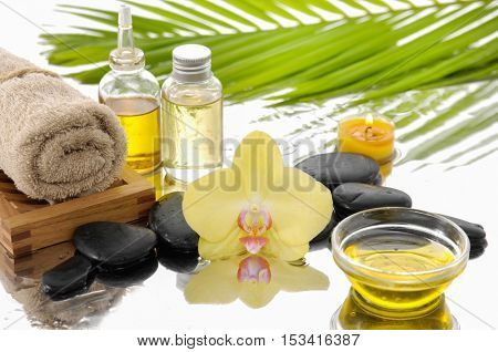 spa concept with palm ,towel, orchid,stones,oil