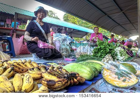 Kota Belud,Sabah-Oct 23,2016:Local trader selling various vegetables at a local market Tamu in Kota Belud,Sabah.Its a place where all farmers,fishermen & vendors gathers weekly to sell their products