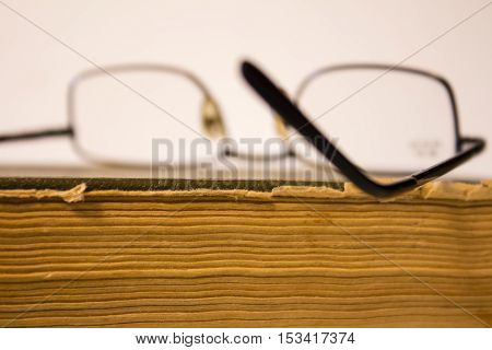 glasses on the book,reading book,poor eyesight,the book is on the table