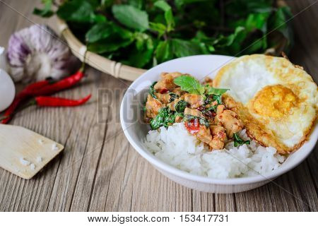 Kapro Gai Kai Dao, Stir Fried Basil Cicken on wooden Thai Famous Food Thai Street Food Thai Cuisine Thai Spicy Food