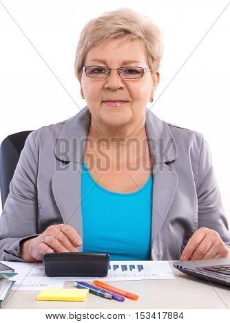 Elderly Business Woman Working At Her Desk In Office, Analysis Of Sales Plan, Business Concept
