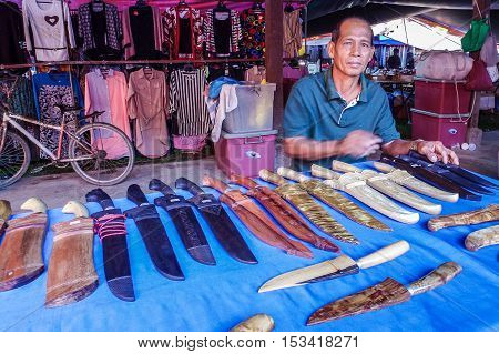 Kota Belud,Sabah-Oct 23,2016:Knives & swords seller at Tamu Kota Belud,Sabah.It is a place where all farmers,fishermen & vendors gathers weekly to sell their products,its a popular tourist destination
