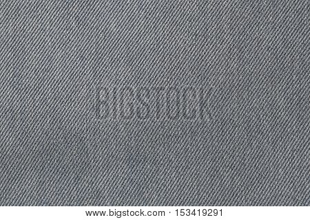 fabric pattern texture of denim or black jeans for the design abstract background.